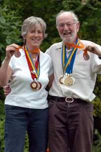 Triathletes Kim and Mike Hall with some of their medals