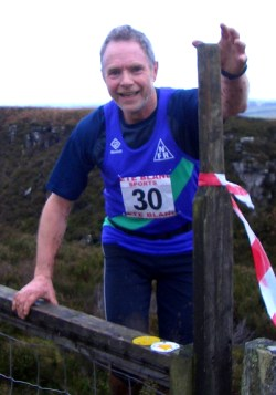John Metson, looking very fresh at a stile.