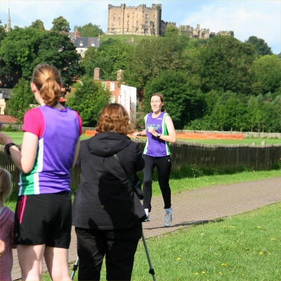 Jo finishes the run with the castle in the background.