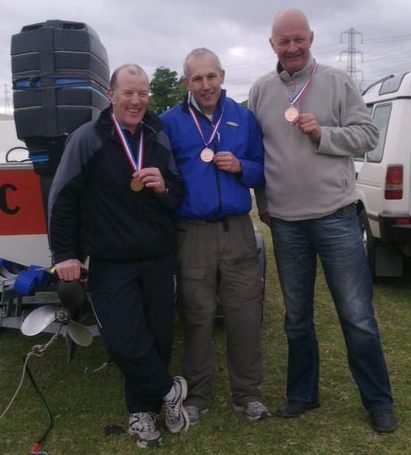 Steve Graham, Geoff and Cliff with medals.