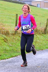 Camilla running into 77th place at the Commondale Beacon Fell Race 2014