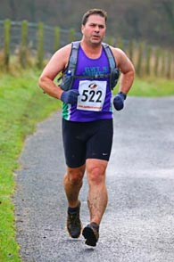 Phil running into 84th place at the Commondale Beacon Fell Race 2014