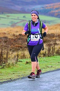 Anita running into 86th place at the Commondale Beacon Fell Race 2014