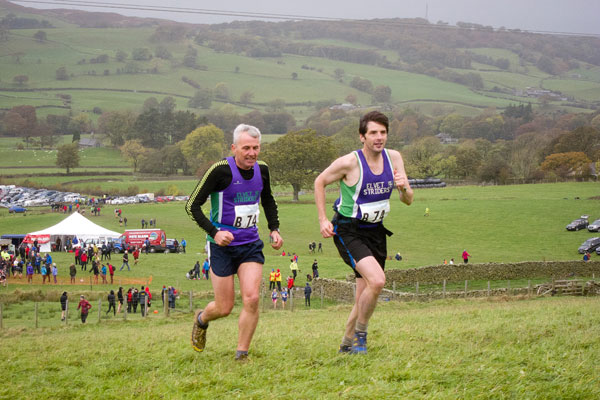 Mike Hughes & Paul Evans climb away from the showground at the start of Leg 2