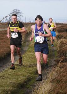 Paul Evans heads for a well deserved 17th place at Guisborough 3-Tops Fell Race 2014