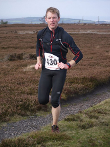 David approaching the final trig point at Guisborough 3-Tops Fell Race 2014