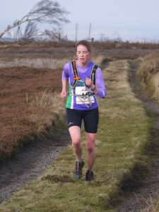 Rachael approaching the final trig point at Guisborough 3-Tops Fell Race 2014