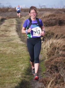 Camilla approaching the final trig point at Guisborough 3-Tops Fell Race 2014
