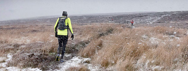 With the snow blowing horizontally, runners make their way over the uninviting moor in the 21st Angus Tait Memorial Hexhamshire Hobble