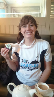 Kerry celebrates her success after the Castles Marathon
