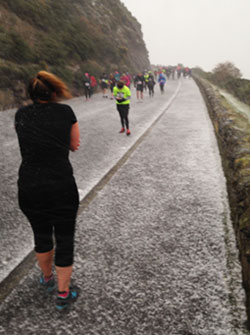 Hailstones batter the runners around Arthur's Seat