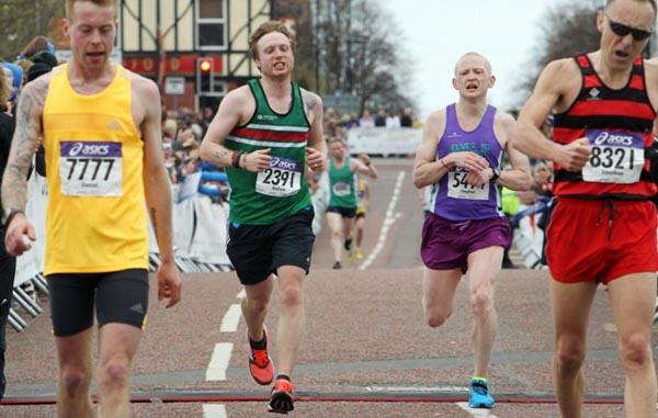 Steven crosses the line at the Asics Manchester Marathon 2015