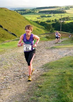 Penny finally overhauls a fast-finishing Graeme on the 'velvet path' climb to the finish of the Saltwell Harriers' Fell Race