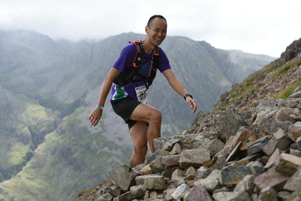 Photo of Danny Lim traversing boulder field.