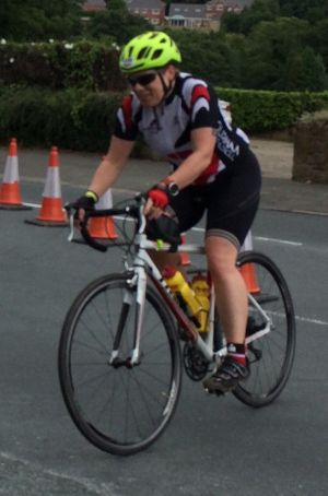 Photo of Debs taking corner on bike.
