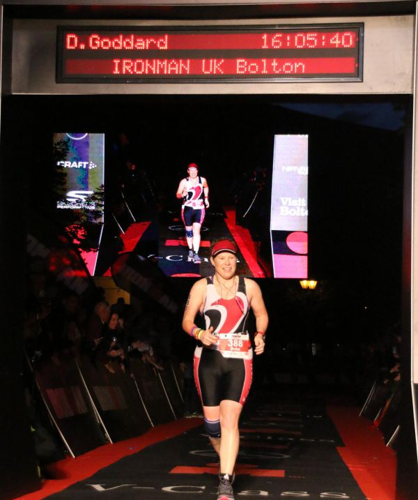 Photo of Debs at the finish with red carpet and timer.